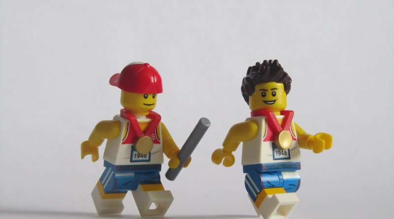 lego men running a relay race